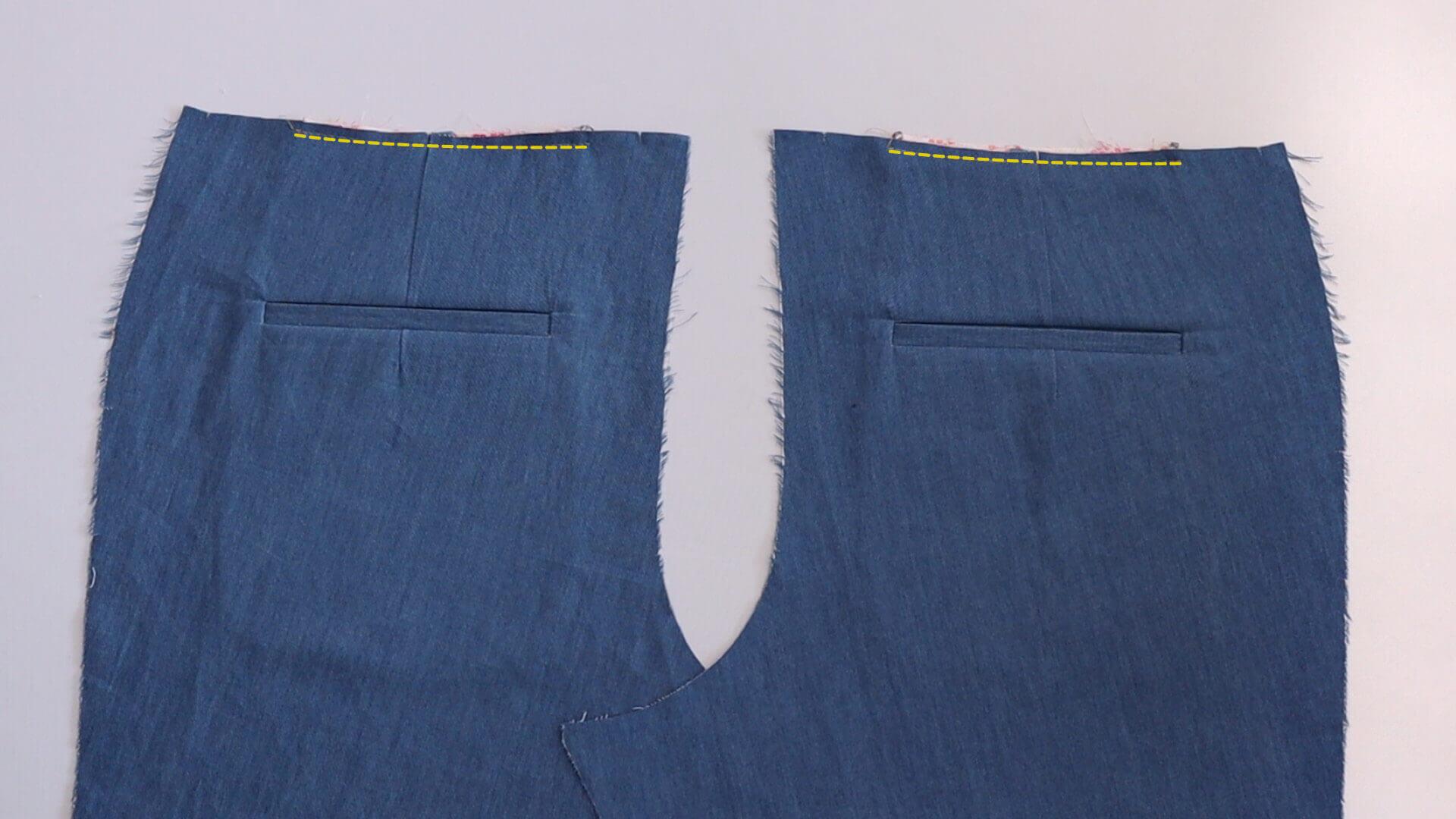 Nähanleitung einseitige Paspeltasche- Arbeitschritt: oberkante Taschenbeutel mit Hilfsnaht an Hinterhose