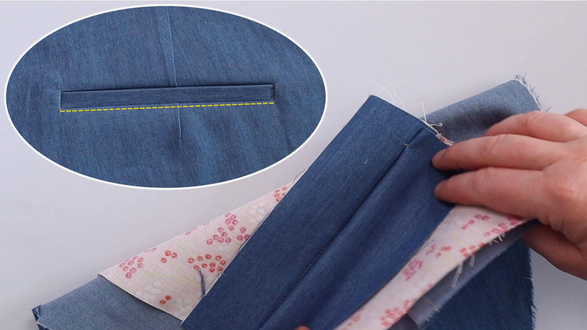 Hochklappen des Taschenbeutelbeleges vor dem Absteppen der unteren Paspelansatznaht beim nähen einer einseitigen Hosentasche